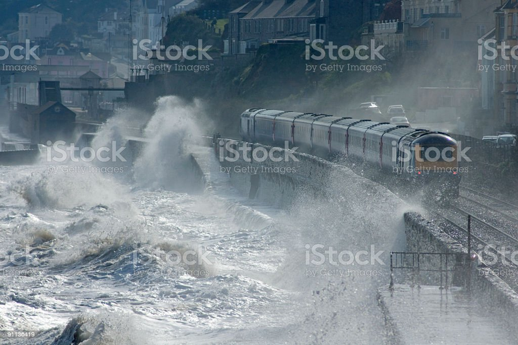 High speed train leaving Dawlish in a storm stock photo