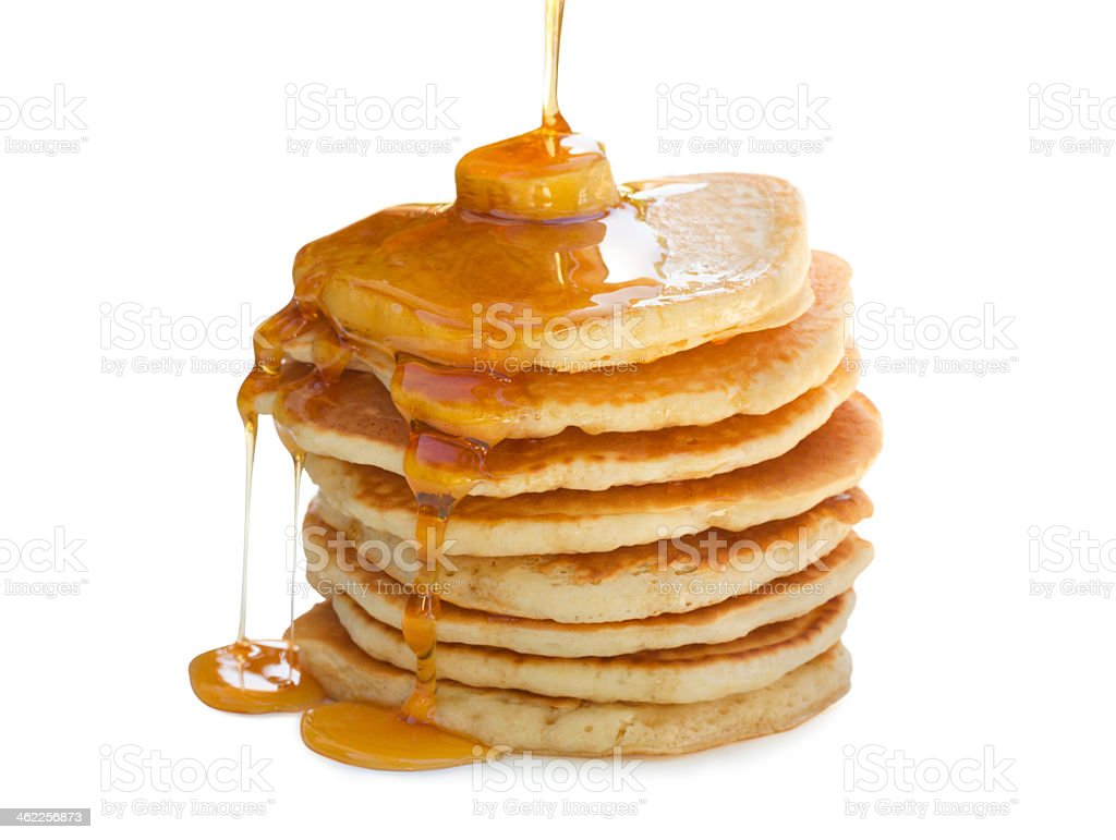 A high stack of pancakes, having syrup poured on top stock photo