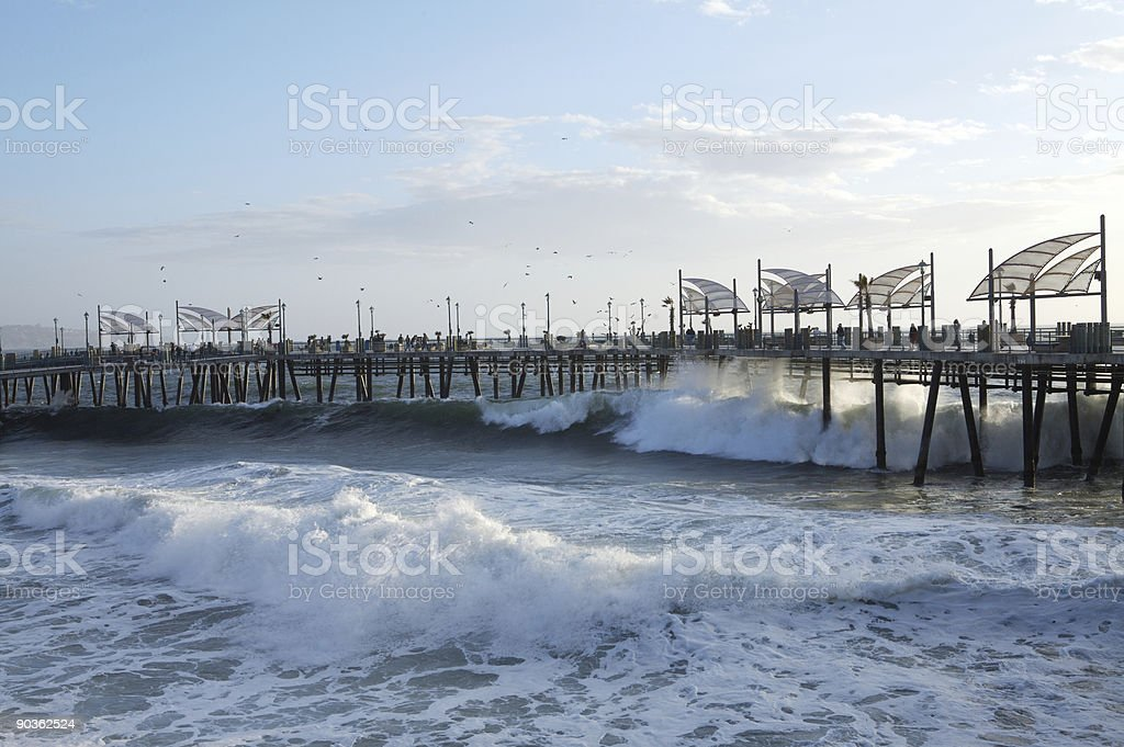 High Surf hitting the pier royalty-free stock photo