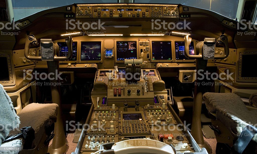 High tech airplane cockpit at night stock photo