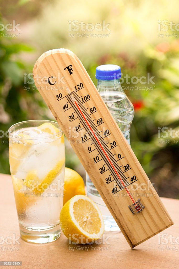 High temperature on a thermometer and water with ice