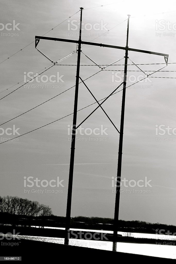 High tension electrical wires and towers in wetland area royalty-free stock photo