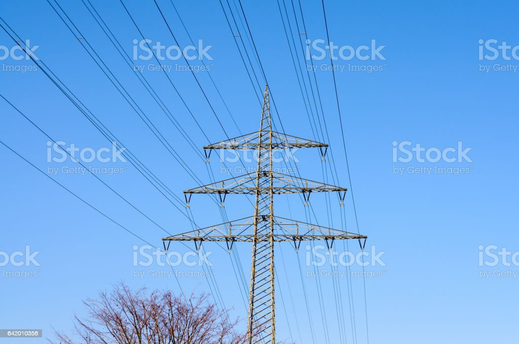 High tension power lines in sky stock photo