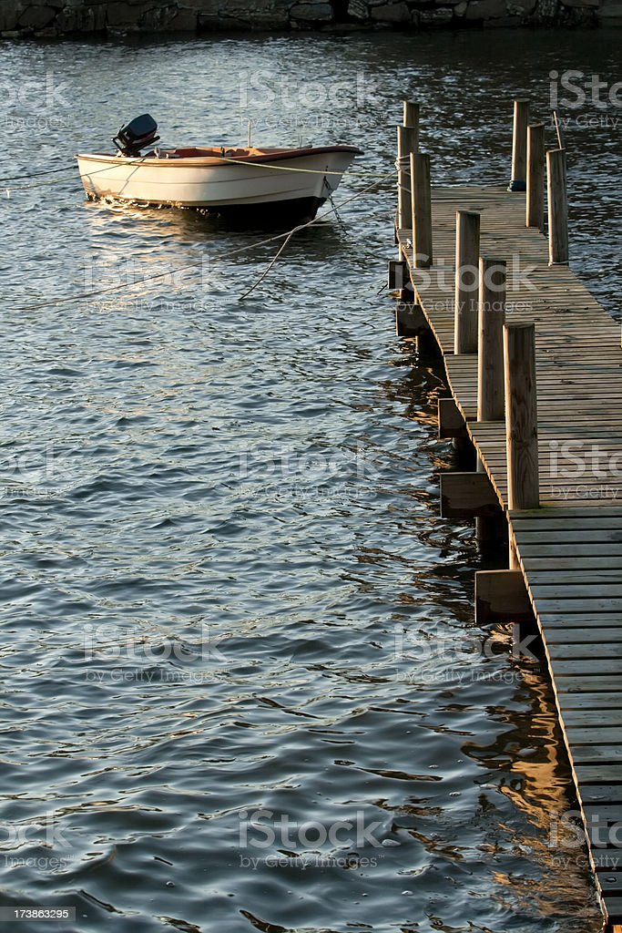 High tide in  harbor  with boat and dock at sunset. royalty-free stock photo