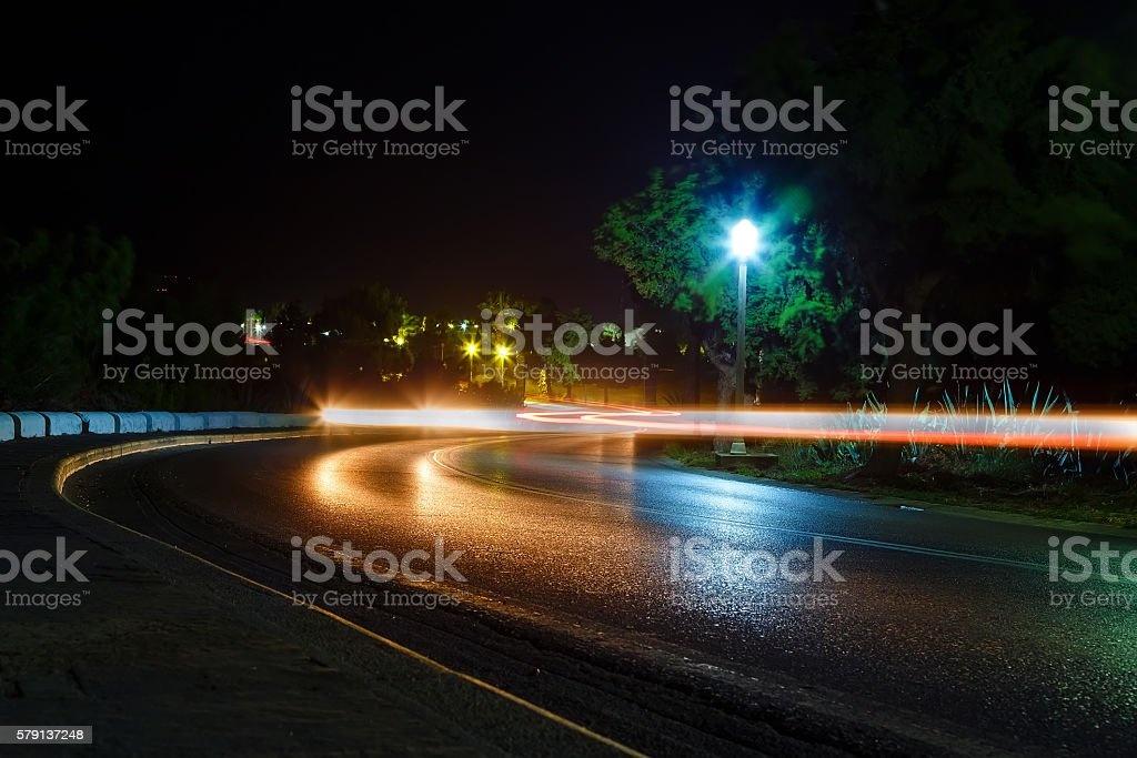 High traffic road with motion blurred automobile stock photo