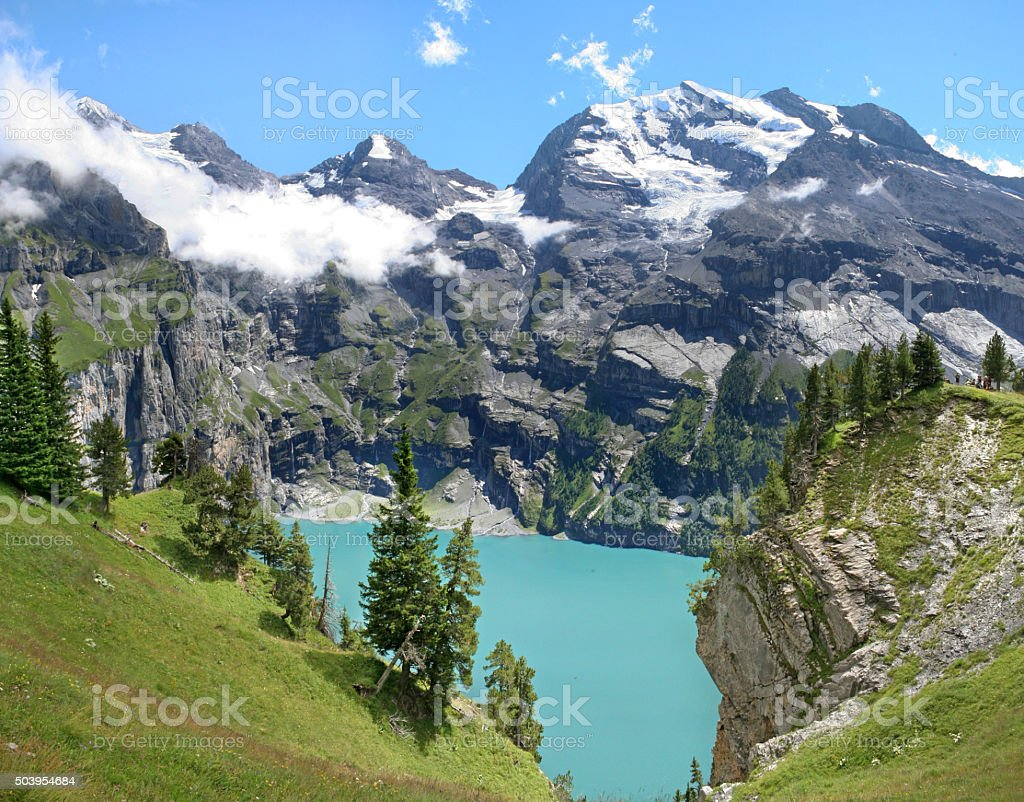 High view at Lake Oeschinensee and mountains in the Alps stock photo