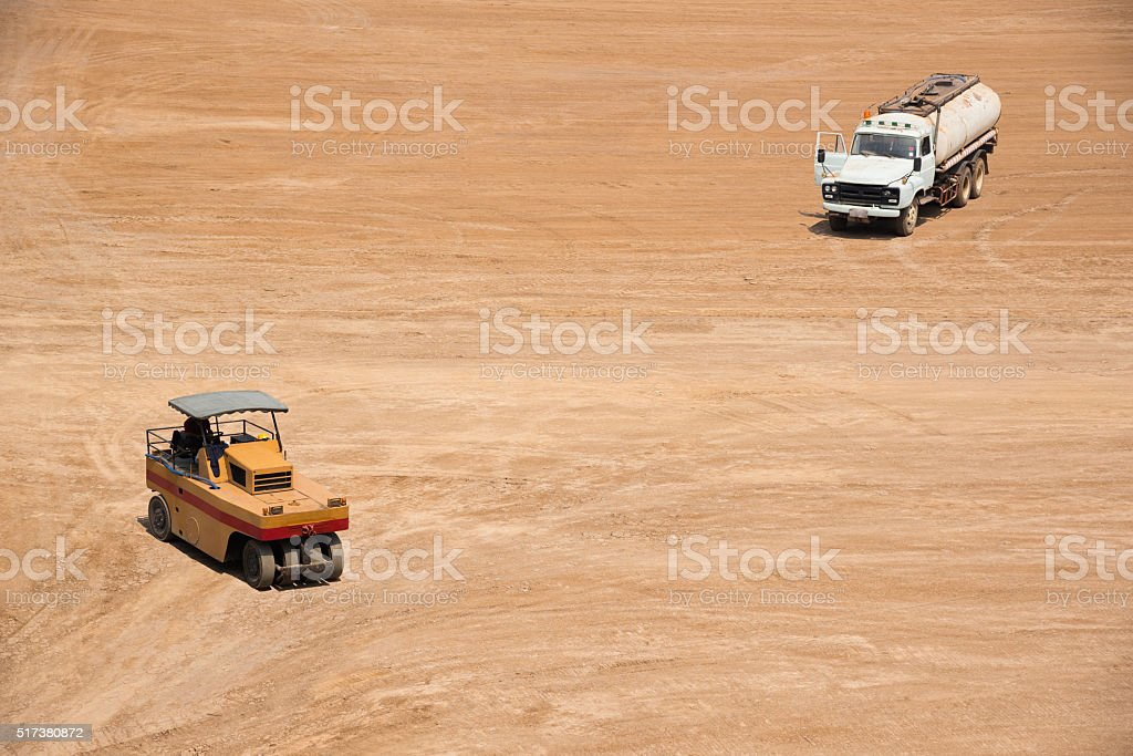 High View Of Space Of Construction Site With Compactor And Water stock photo
