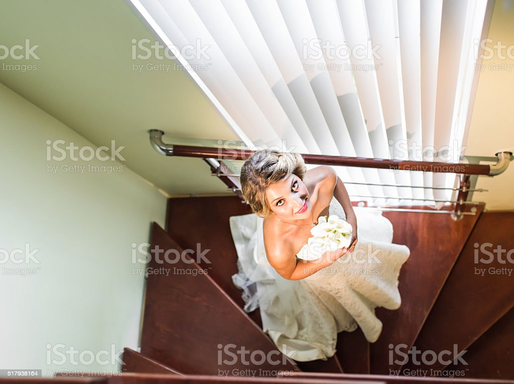 High View Portrait Of Beautiful Happy Bride Indoors stock photo