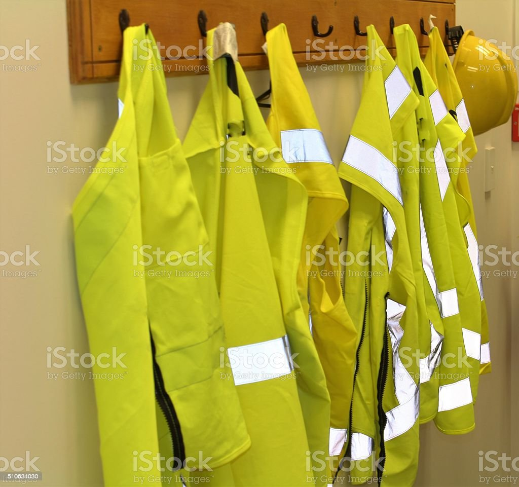 High vis safety vests on a coat rack stock photo