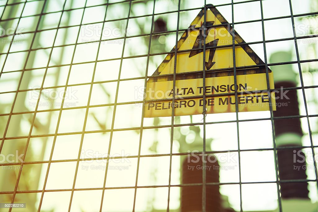 High voltage. Danger of death. Sign with text in spanish. stock photo