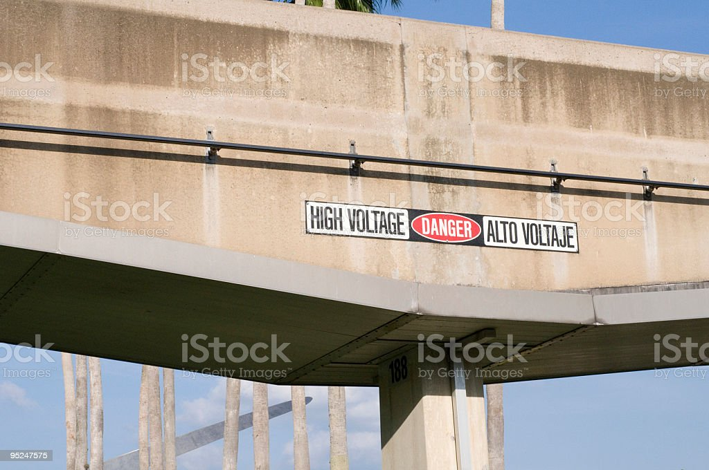 High Voltage Danger Sign on Tram stock photo
