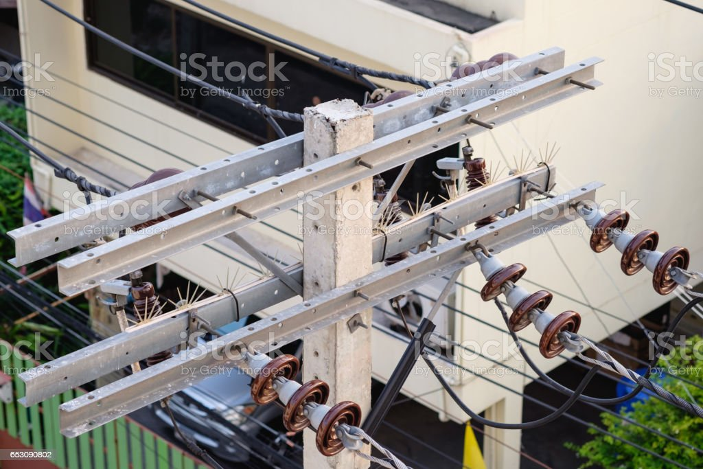 high voltage electric wires and ceramic insulator stock photo