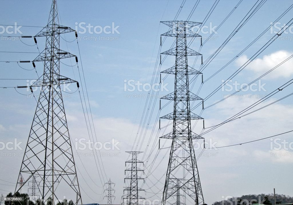 High voltage electric wires on sky background stock photo