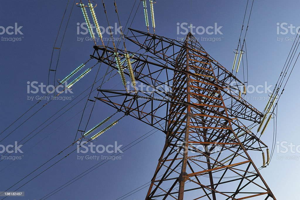 High voltage electrical Power lines against a blue sky. stock photo