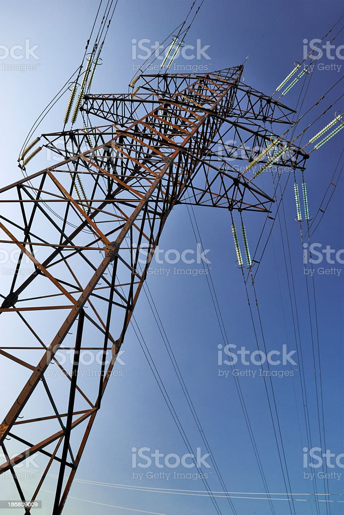 High voltage electrical Power lines against a blue sky stock photo