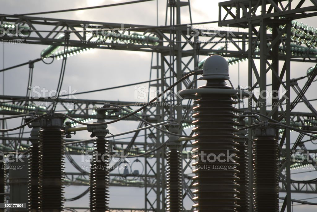 high voltage insulators and cables at a power station stock photo