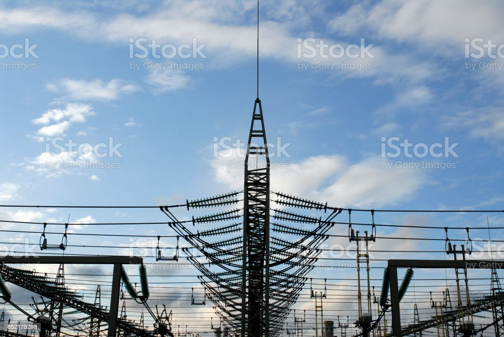 high voltage insulators and cables in a row stock photo