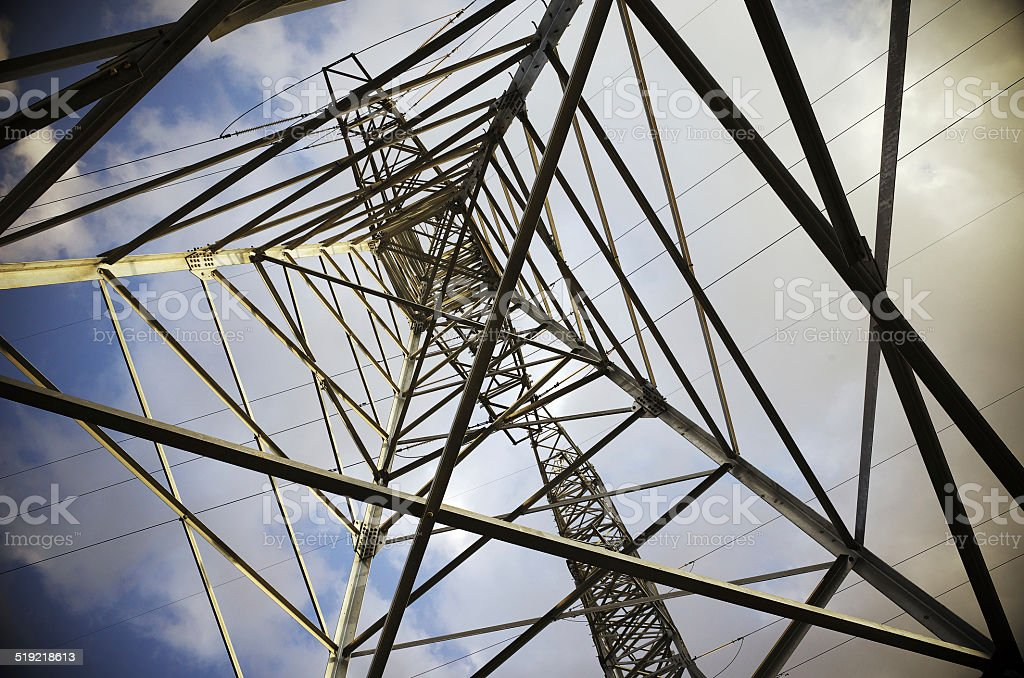 High voltage line in cloudy blue sky stock photo
