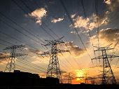 High Voltage Lines, electricity pylon with brightly lit sky