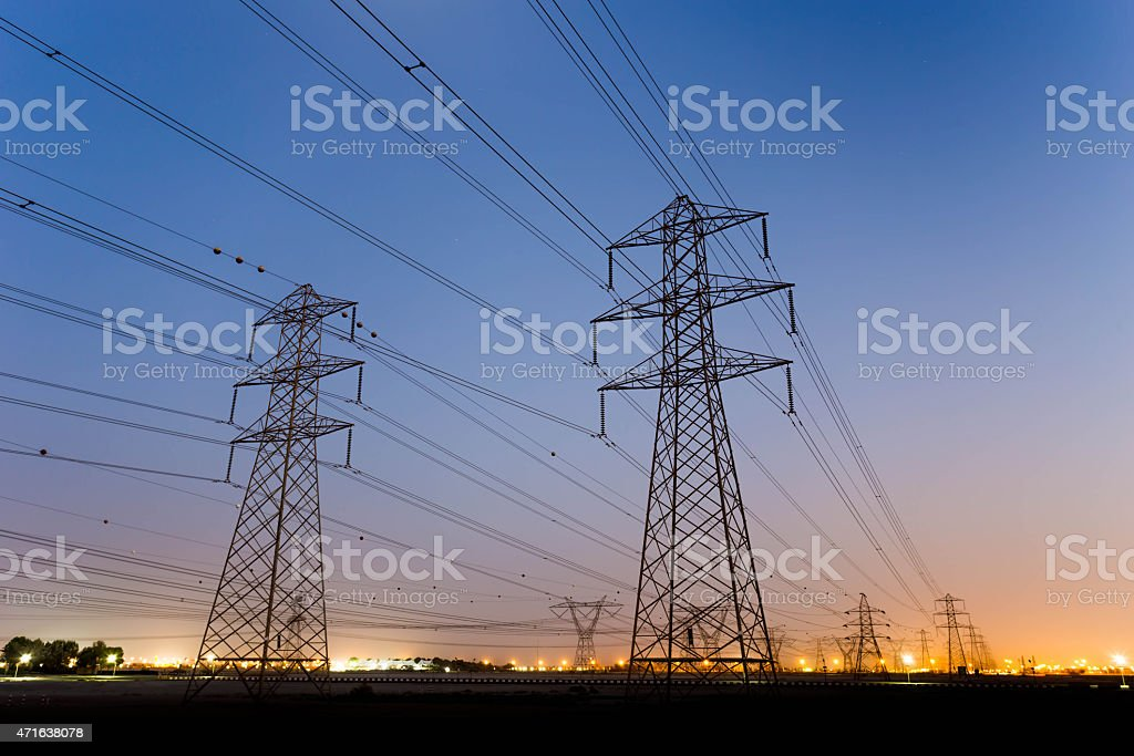 High Voltage Lines, electricity pylon with colorful sky stock photo