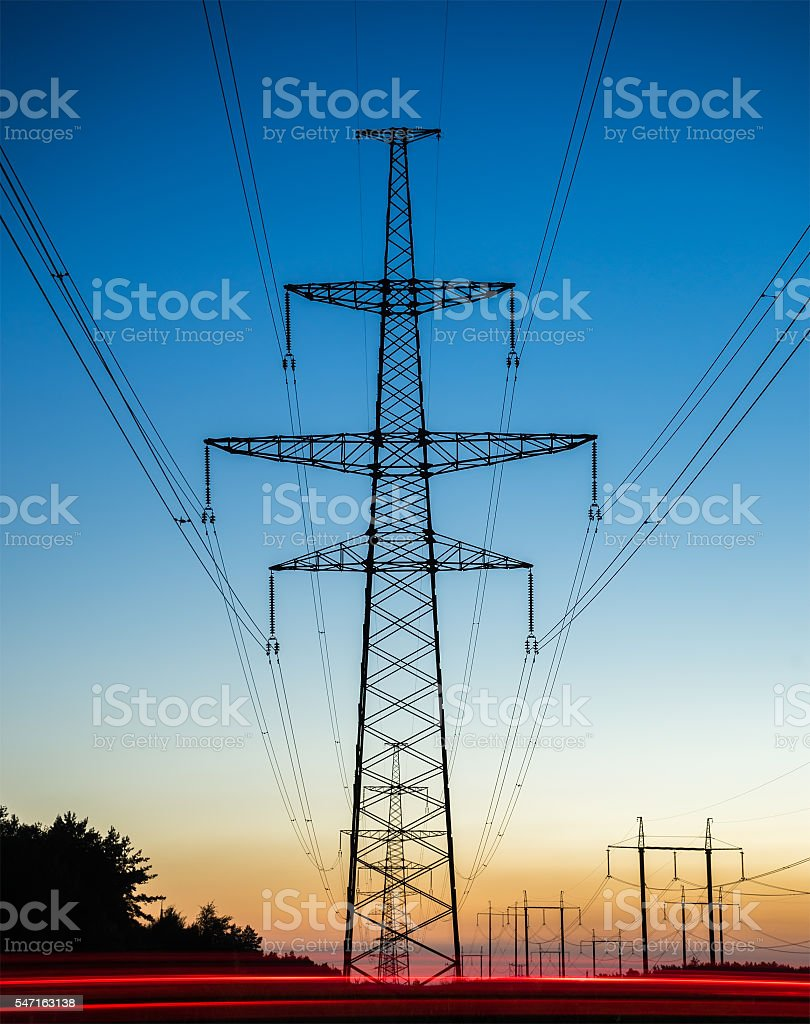 high voltage post. High-voltage tower sky background. stock photo