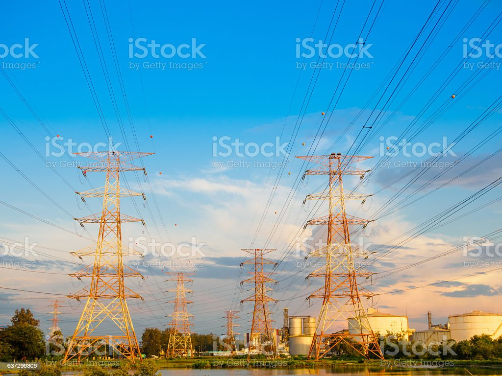 High voltage post or High voltage tower in green field stock photo