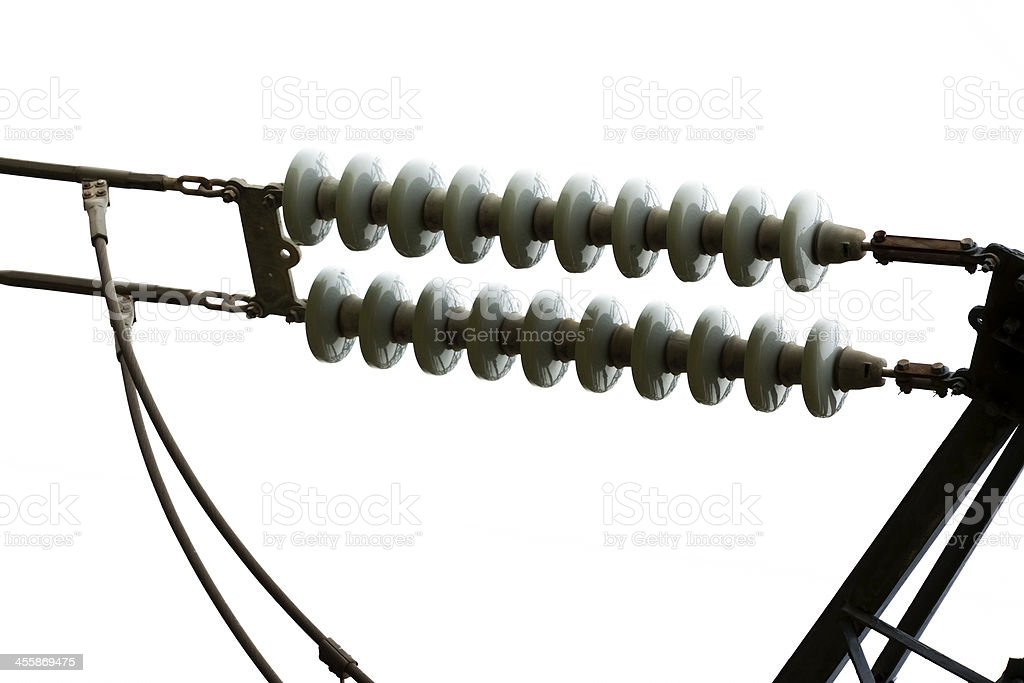 High voltage power line insulators against white background, copy space royalty-free stock photo