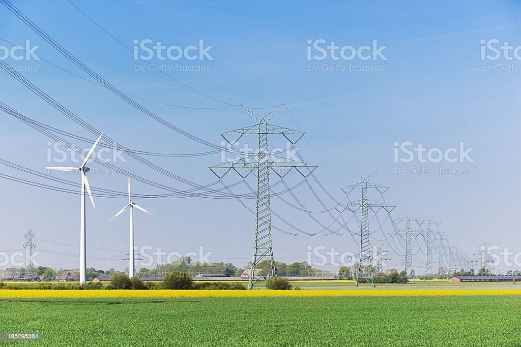 High voltage power lines and windenergy stock photo