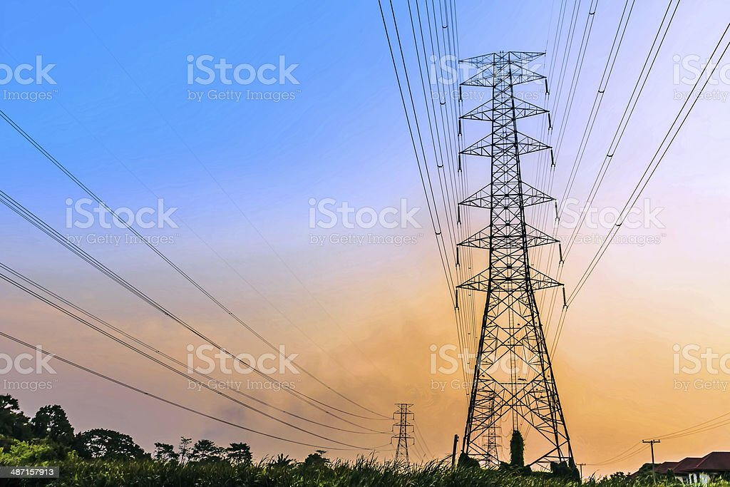 High voltage power lines at sunset. stock photo