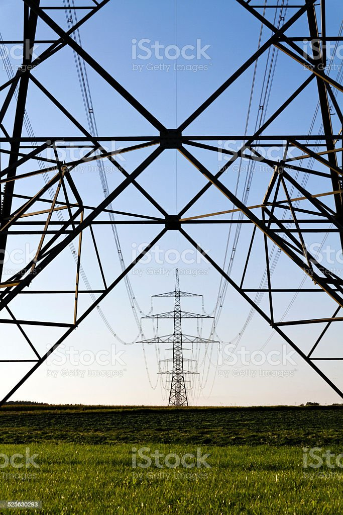 high voltage power pole - silhouette stock photo