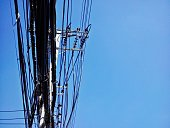 High voltage power pole with wires tangled and communication pole