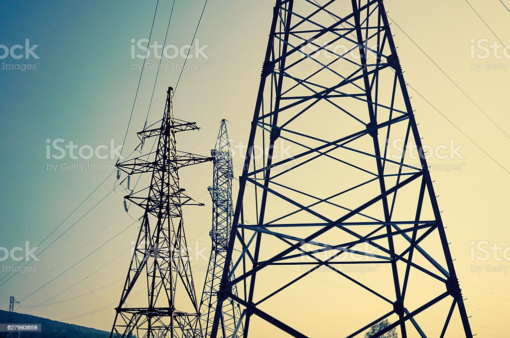 High voltage power tower pylon line cables sky background stock photo