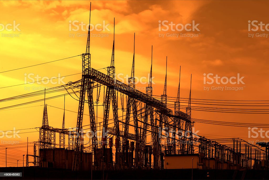 High voltage power transformer substation, sunset stock photo