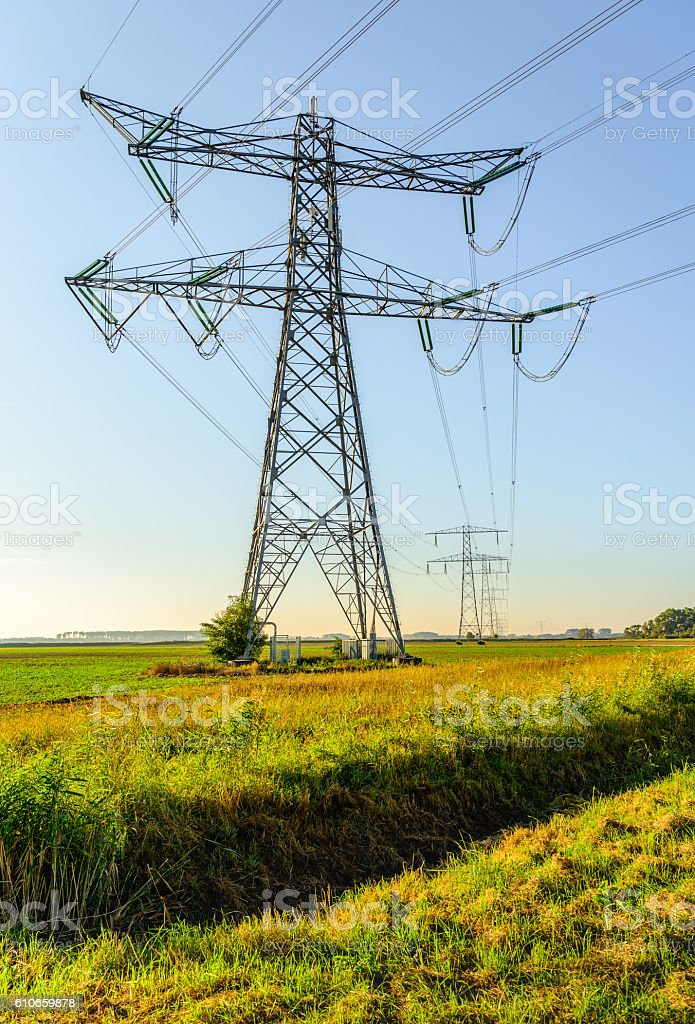 High voltage pylons and cables in a rural area stock photo