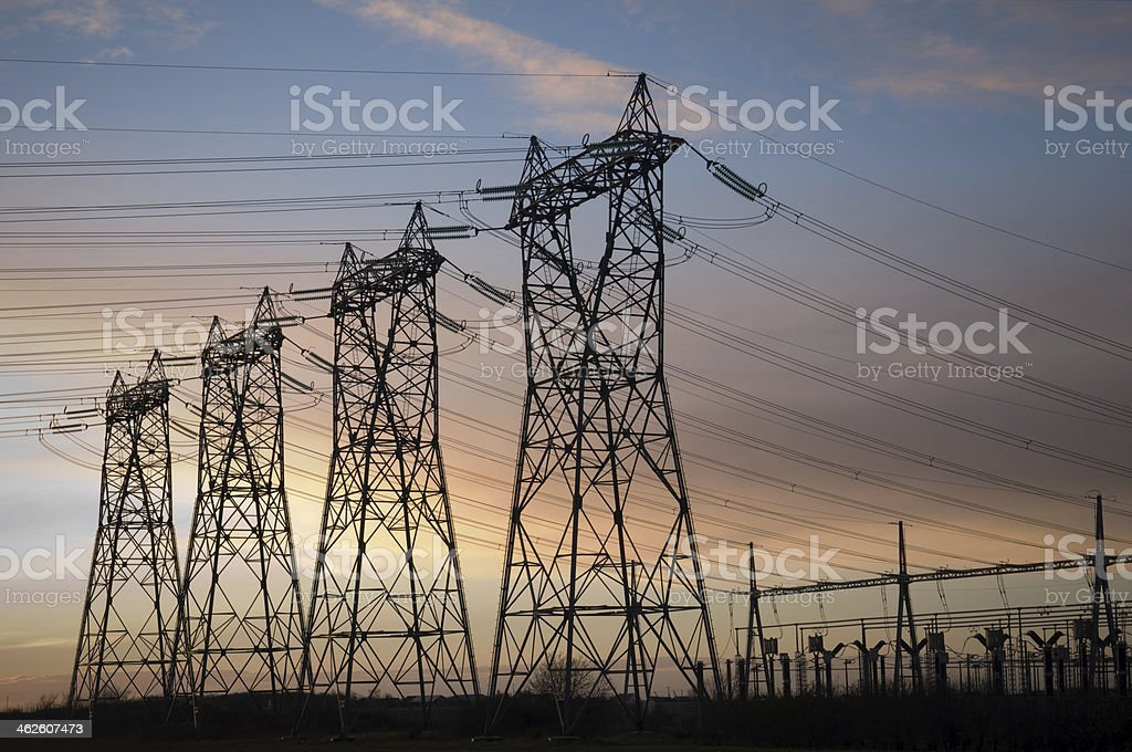 high voltage pylons silhouettes royalty-free stock photo