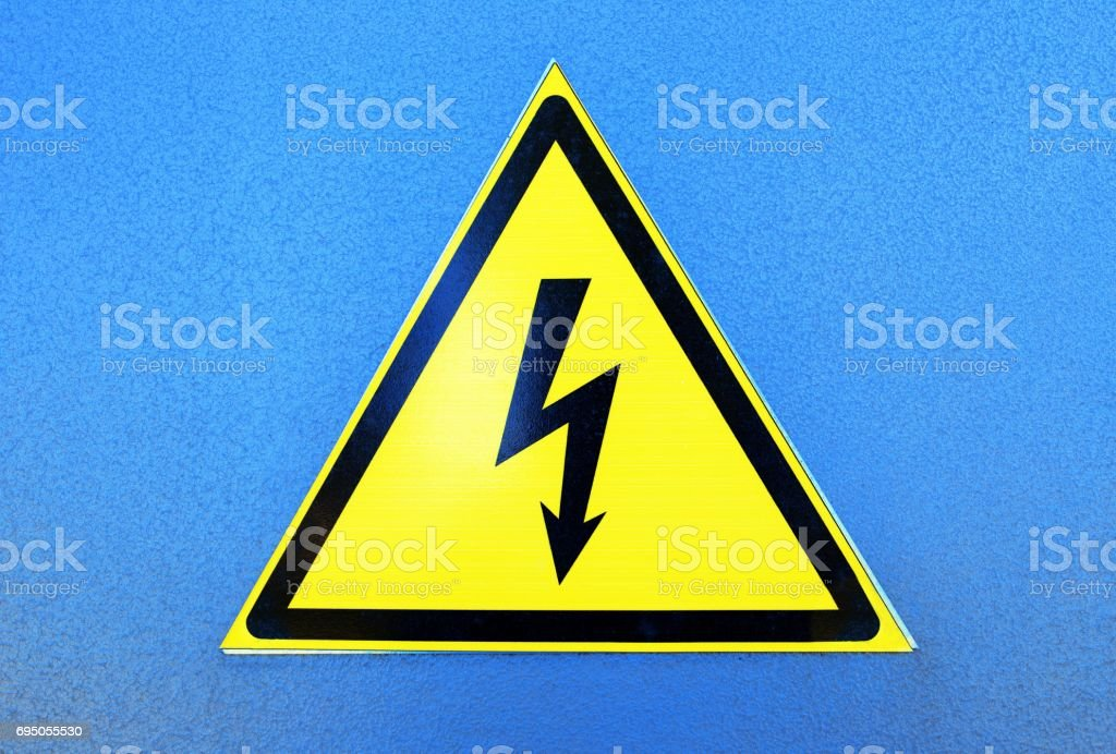 High voltage sign on blue metal plate stock photo