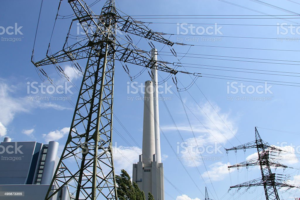High voltage tower and two chimneys stock photo