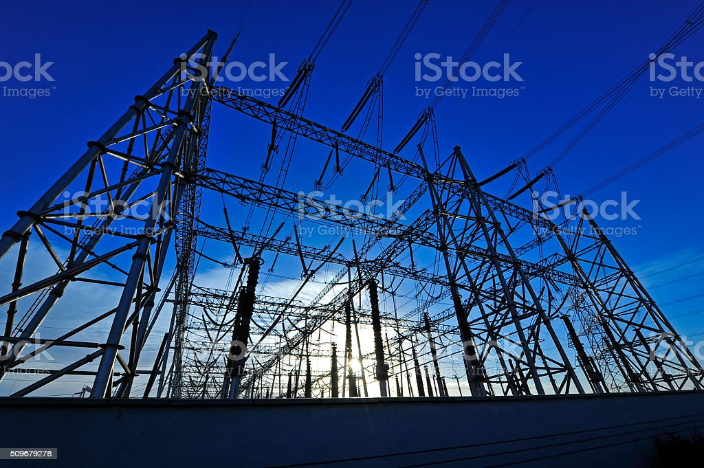 High voltage towers and power lines stock photo