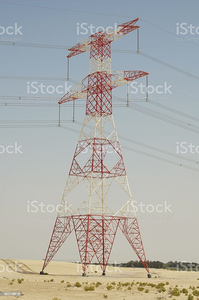 High voltage transmisson pole in desert stock photo