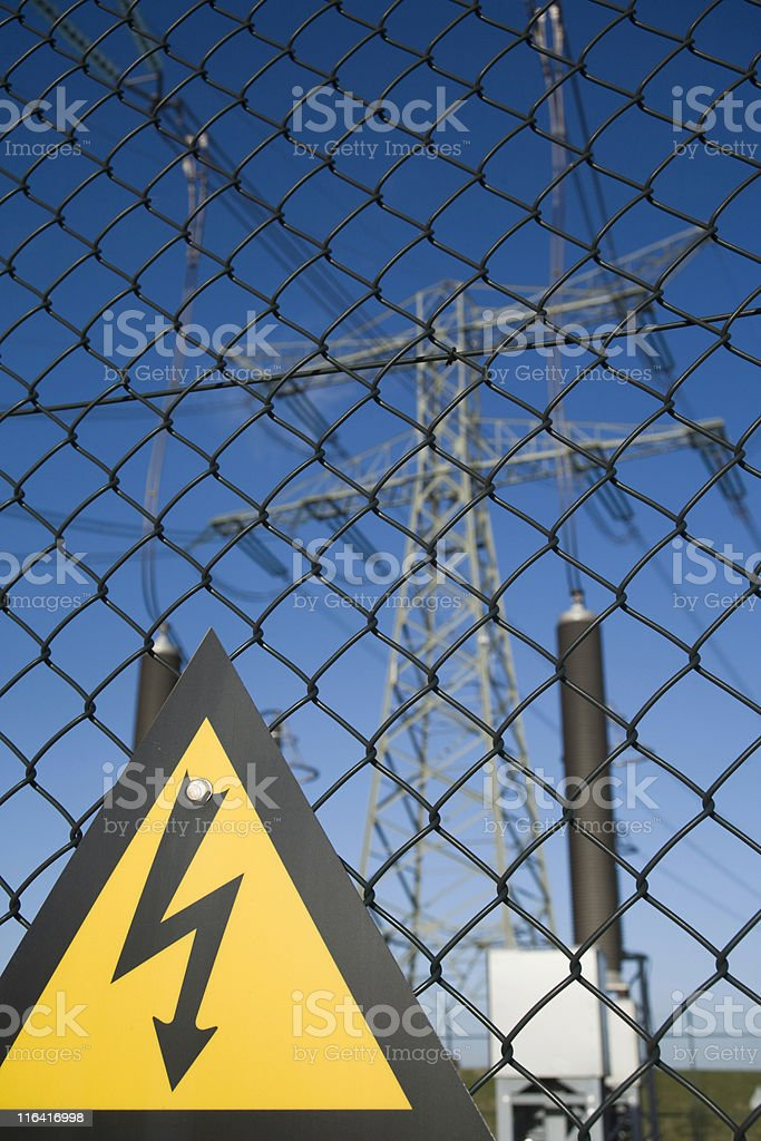 high voltage warning on a fence of an electricity substation stock photo