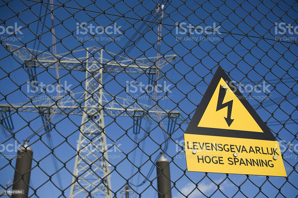 high voltage warning on a fence of an electricity substation royalty-free stock photo