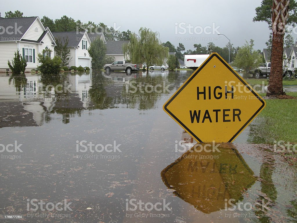 High Water Sign in Flooded Neighborhood stock photo