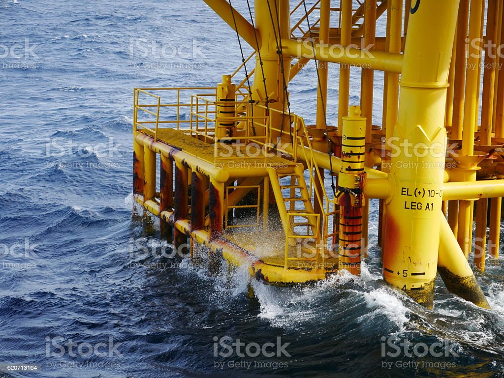 High wave hitting the Boat Landing and Producing Slots stock photo