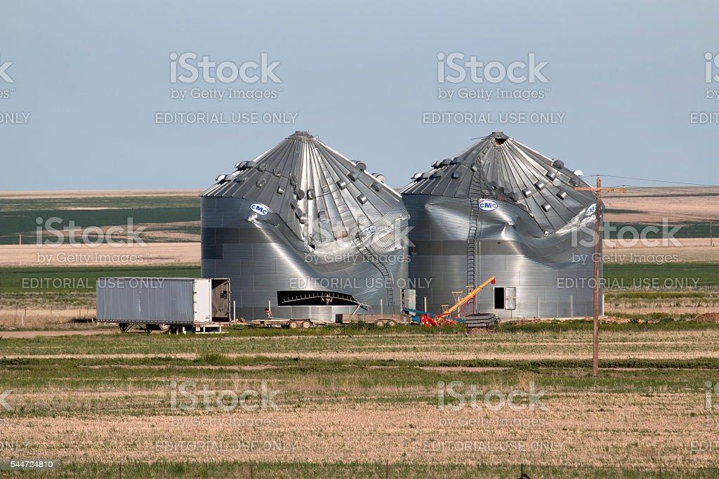 High wind damaged granaries Colorado plains farm stock photo