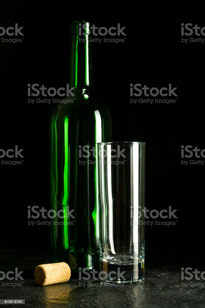 High wine glass made from green glass. No content. Glass and cork. Low key. stock photo