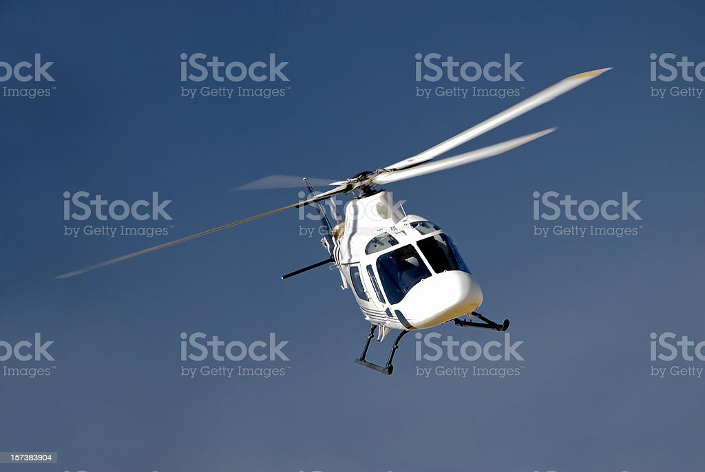 High-banking helicopter stock photo