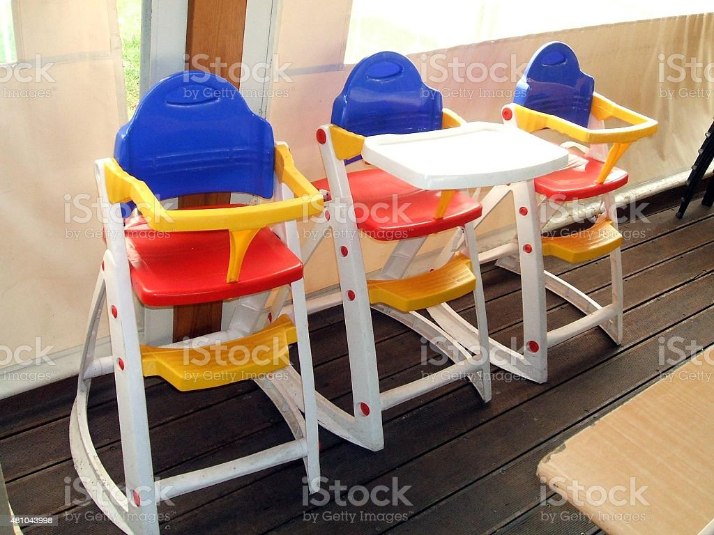 highchairs or booster seats for children stock photo