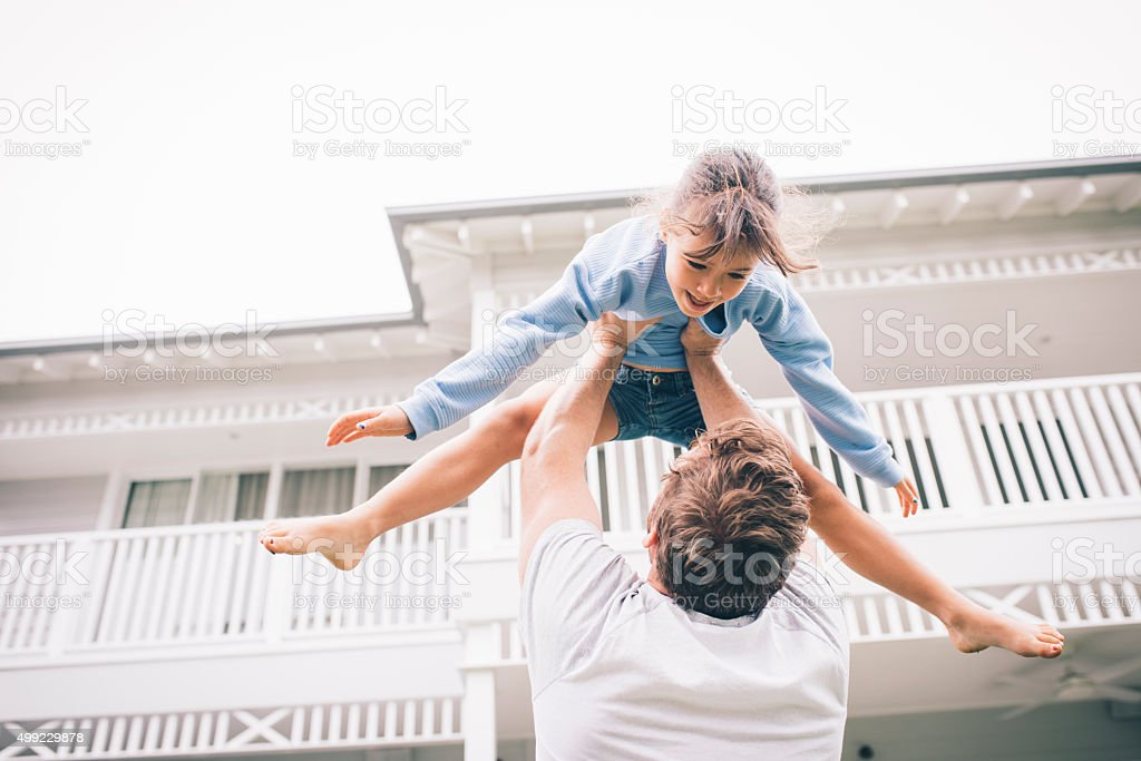 Higher, daddy! stock photo