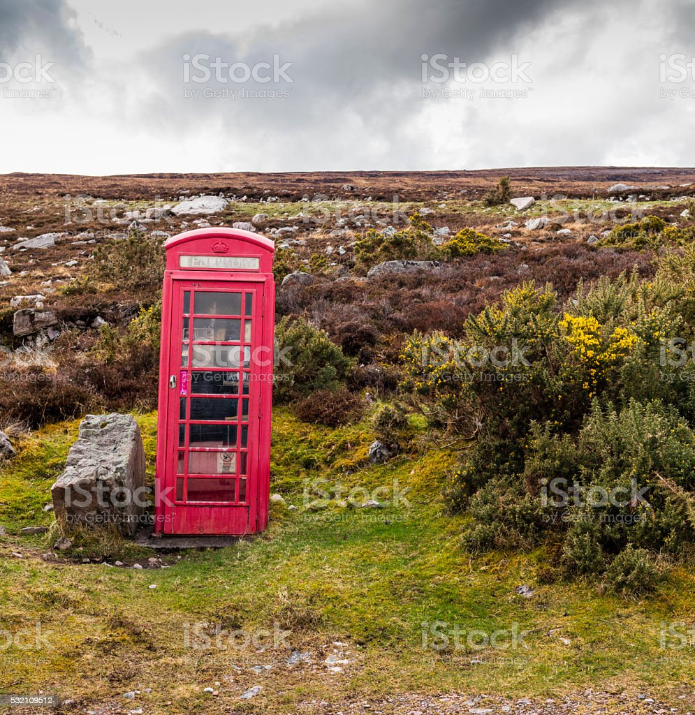 Highland, Scotland. Typical red telephone box on Loch Eriboll stock photo
