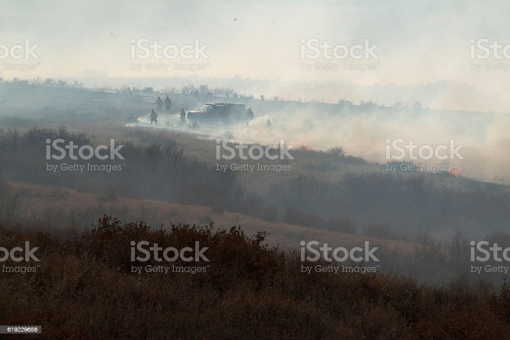 Highlands Ranch Colorado Chatridge Fire firefighters extinguish wildfire smoke ash stock photo